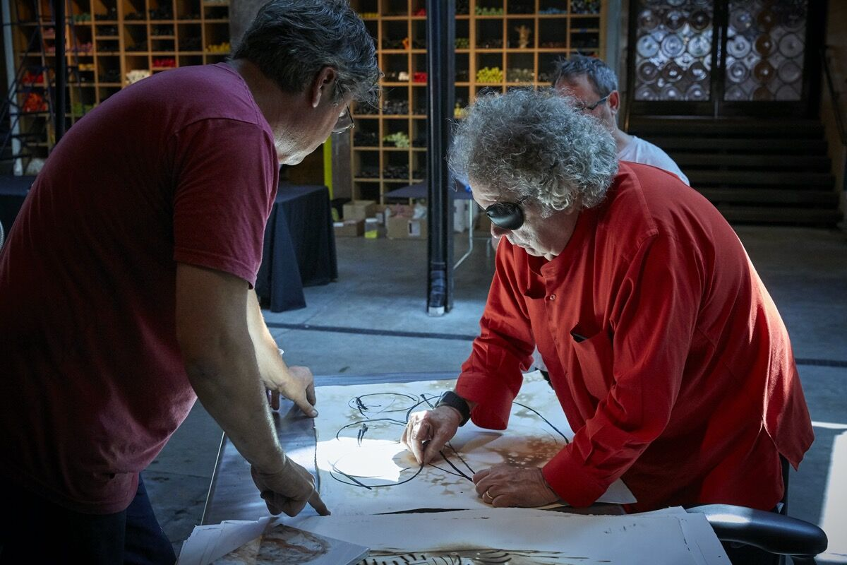 James Mongrain and Chihuly in The Boathouse hotshop, Seattle, 2019. © Chihuly Studio. All Rights Reserved. Photo by Scott Mitchell Leen. Courtesy of Chihuly Studio.
