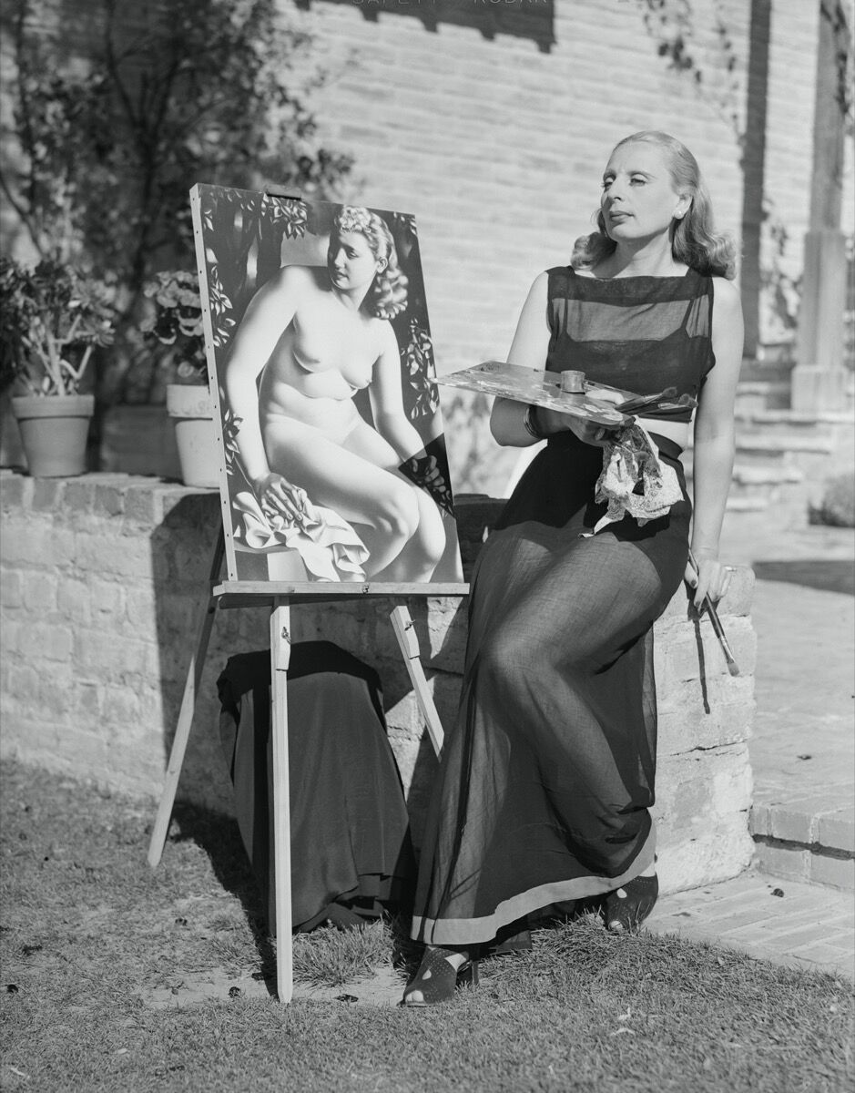 Portrait of Tamara de Lempicka at her easel by Bettmann Archive via Getty Images.