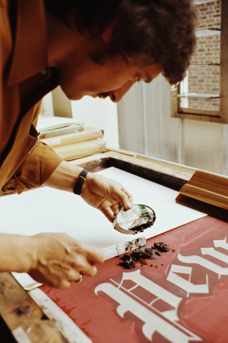 Ed Ruscha working on his mixed-media lithograph Pews, circa 1970. Photo by Tony Evans. Image via Getty Images.