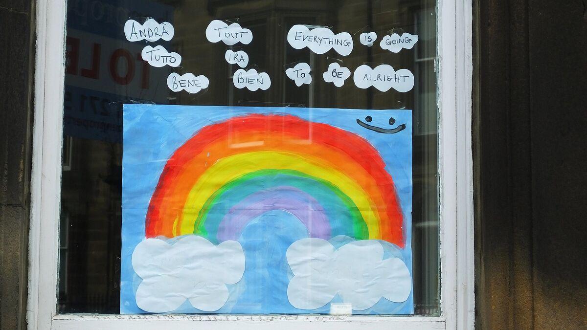 A rainbow sign hanging in an Edinburgh window. Image via Flickr.