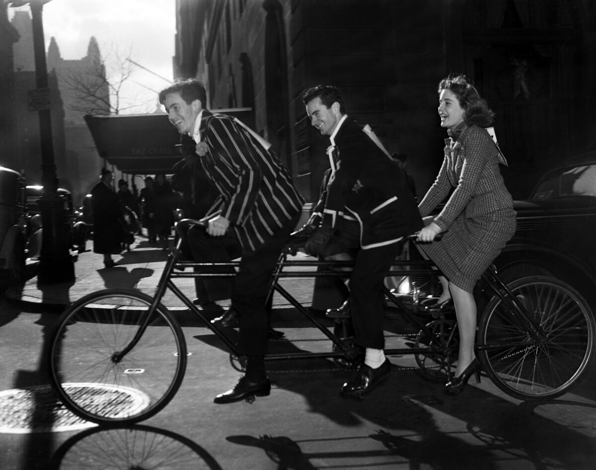 Roger Schafer, Anthony Duke, and Mary Pinchot (front to back) as they head to Central Park, New York City, to take part in the third annual bicycle breakfast and ride of socialites, held for the benefit of the Children' Welfare Federation, 1937. Courtesy of Bettmann/Getty Images.