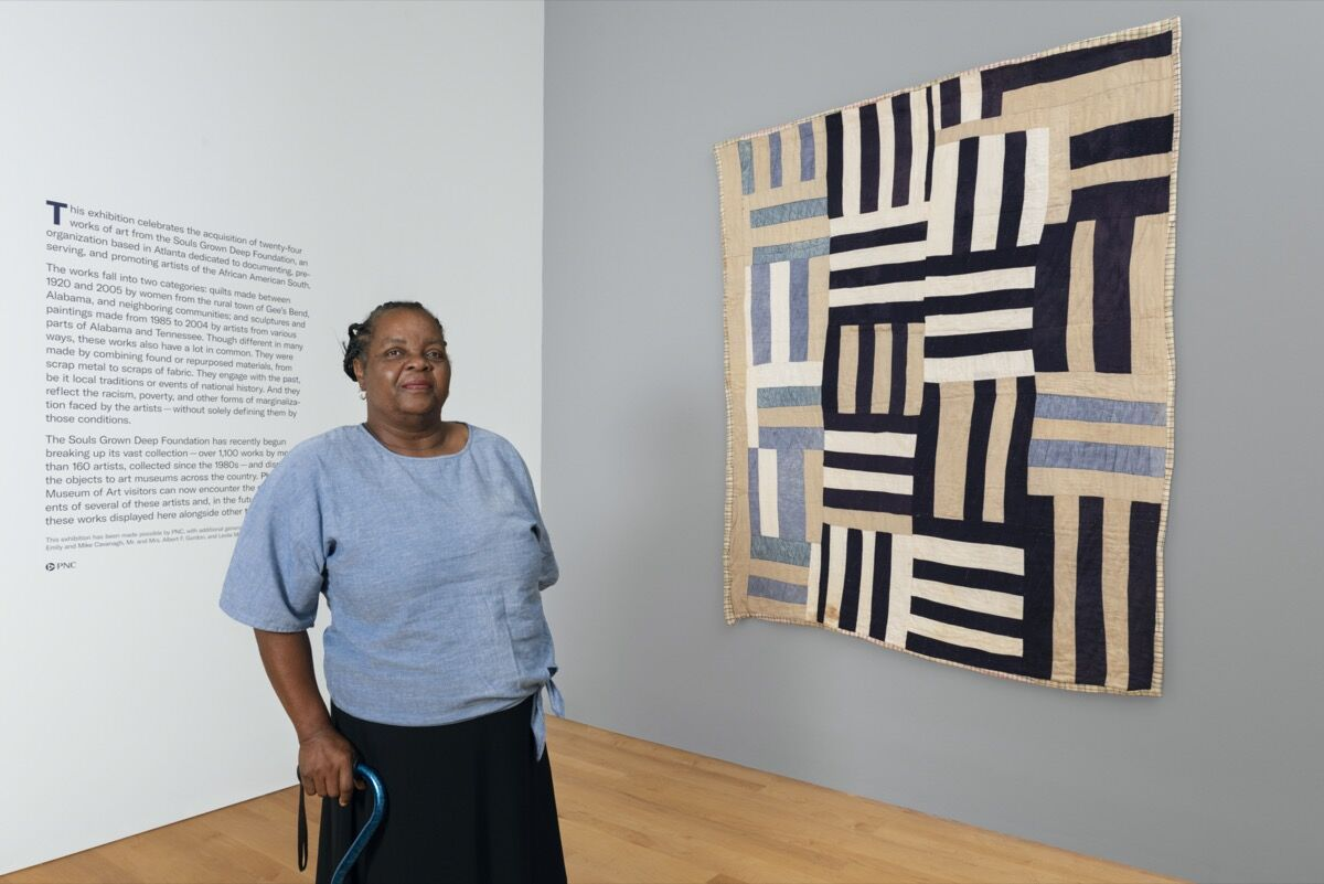 """Gee's Bend quilter Mary Margaret Pettway in the exhibition """"Souls Grown Deep: Artists of the African American South"""" at the Philadelphia Museum of Art, 2019. Photo by Juan Arce. Courtesy of the Philadelphia Museum of Art."""