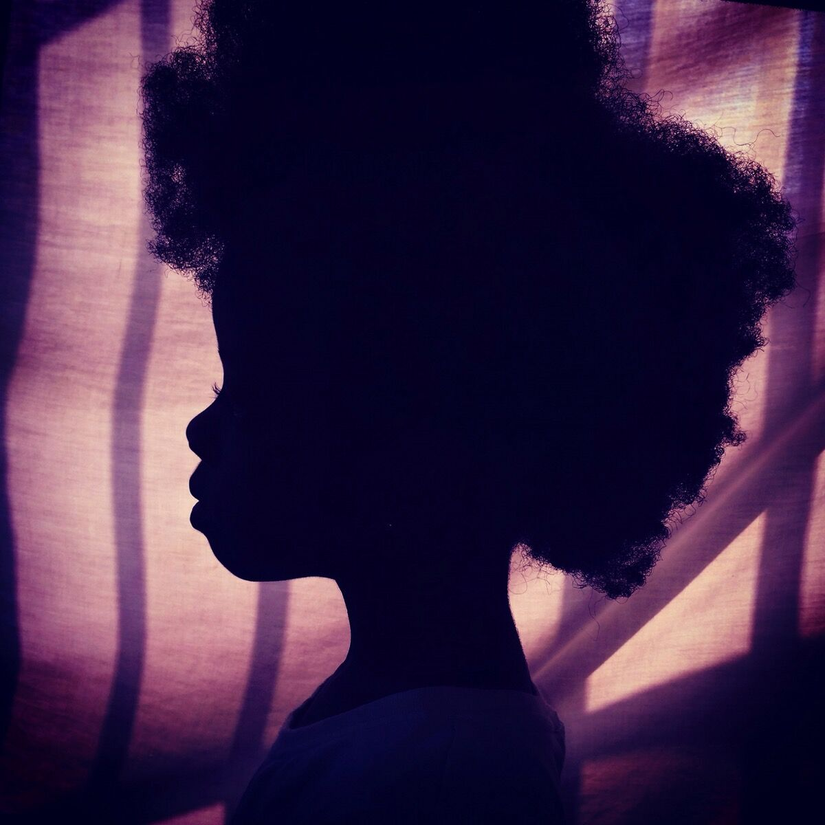 Afro on purple. Silhouette of my daughter. Accra, Ghana. Photo by @africashowboy.