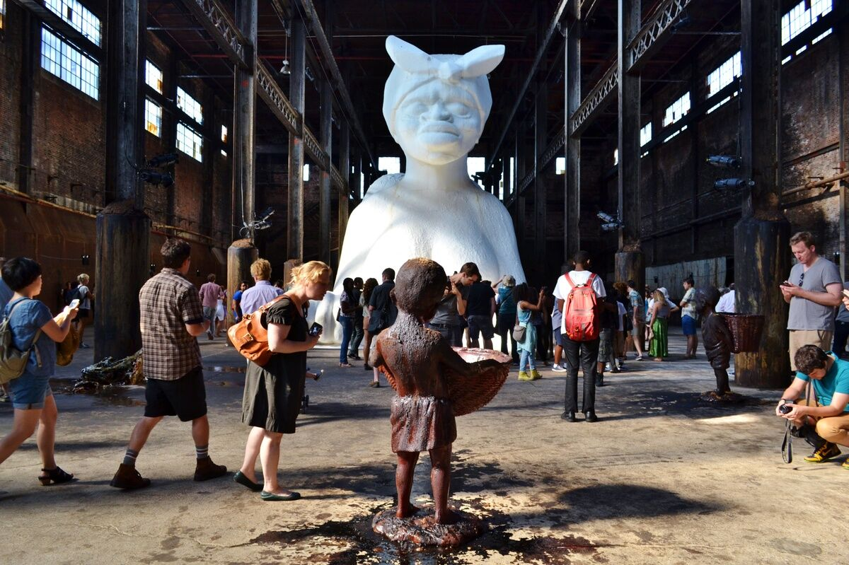 """Installation view of Kara Walker, """"A Subtlety, or the Marvelous Sugar Baby,"""" presented by Creative Time at the Domino Sugar Refining Plant, 2014. Photo by gigi_nyc, via Flickr."""
