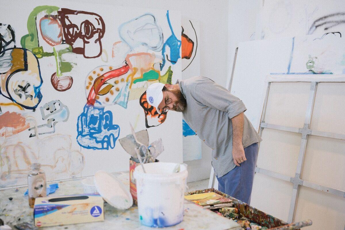Portrait of Eddie Martinez in his studio, 2017. Photo by Charlie Rubin. Courtesy of the artist and Mitchell-Innes & Nash, New York.