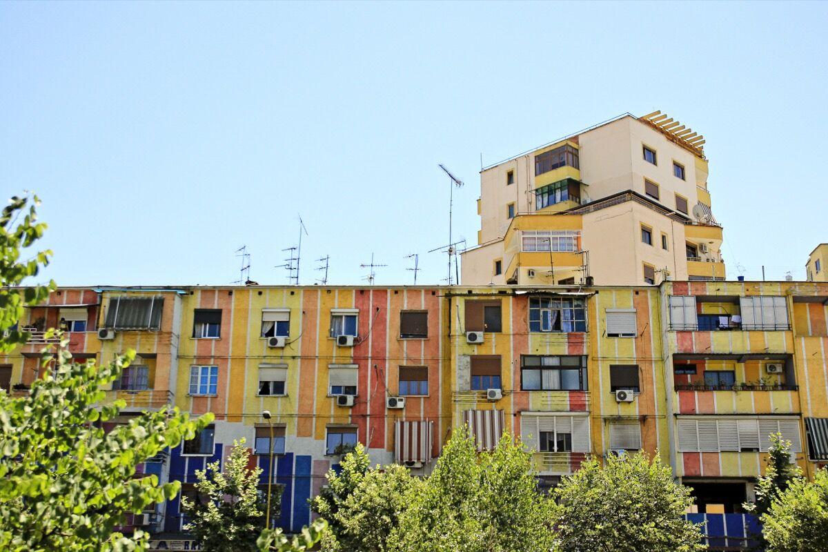 Painted buildings in Tirana, Albania. Photo by Magalie L'Abbé, via Flickr.