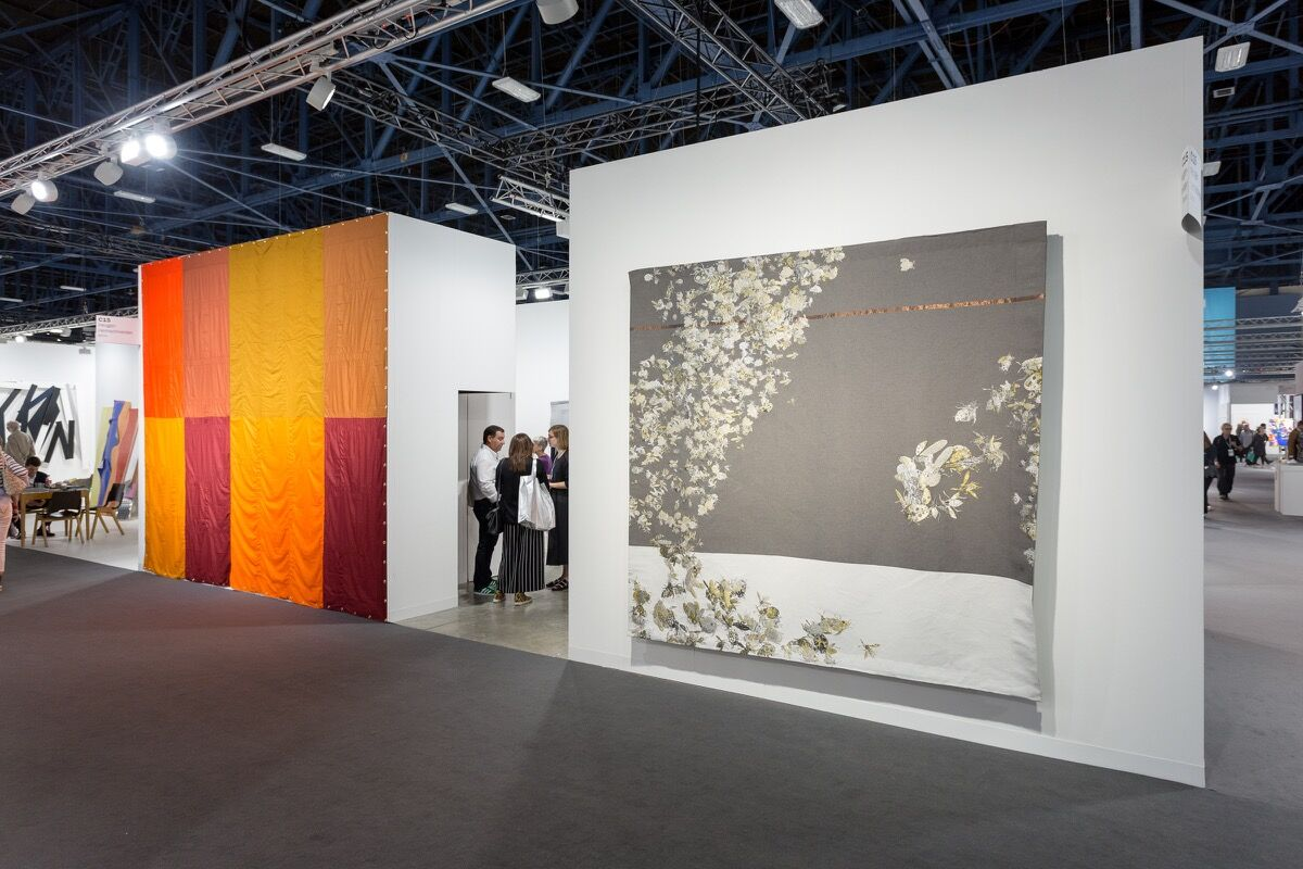 Installation view of neugerriemschneider's booth at Art Basel in Miami Beach, 2016. Photo by Alain Almiñana for Artsy.