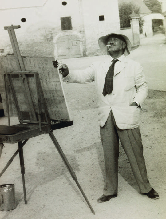Bemelmans at his easel, c. 1958. © 2019 Estate of Ludwig Bemelmans. Courtesy of the Estate of Ludwig Bemelmans.