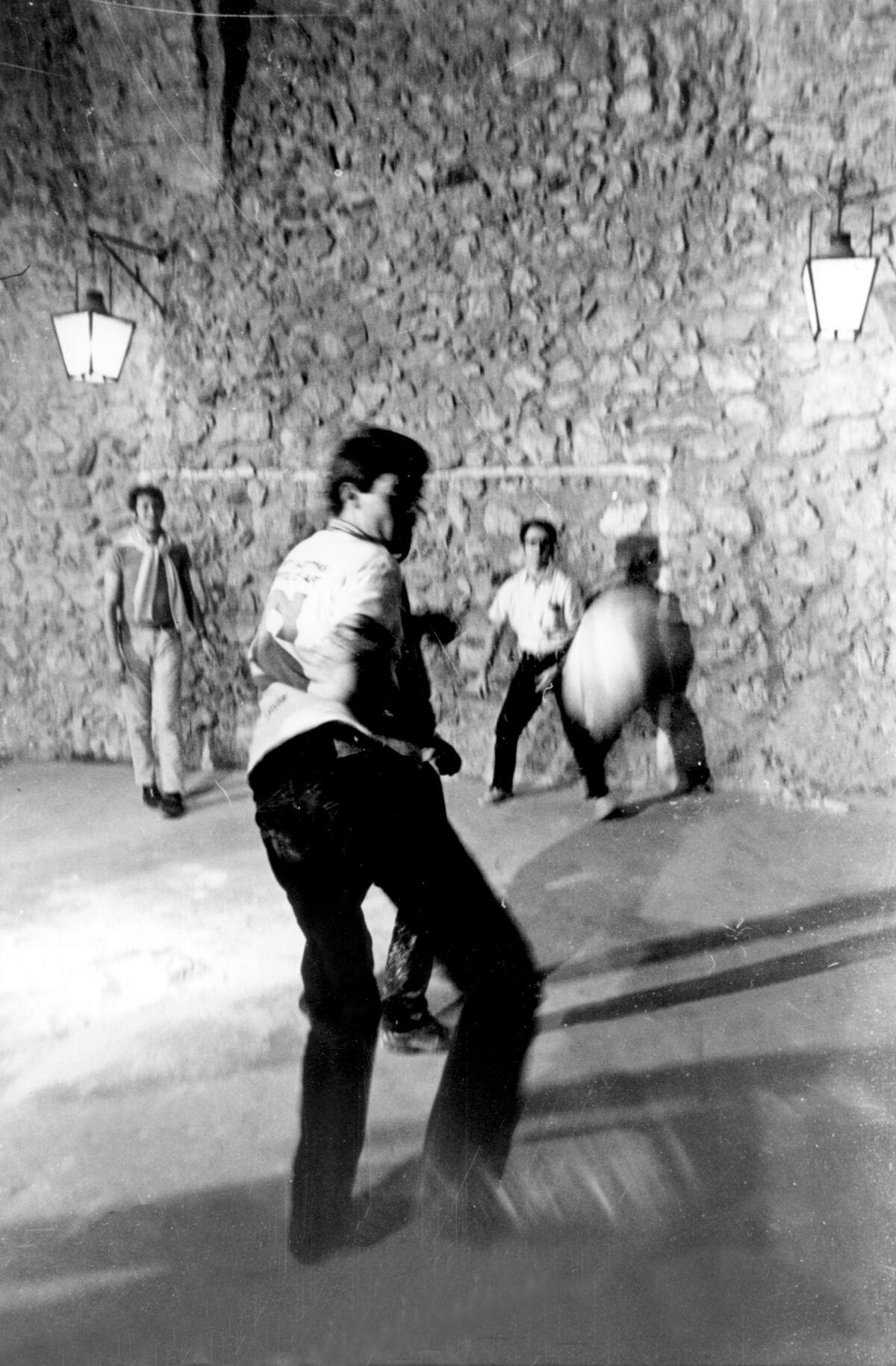 Richard Long, Paolo Icaro, and Francesco Gozzano playing football in the Arsenale. Photo by Bruno Manconi. Courtesy of Archivo Lia Rumma.