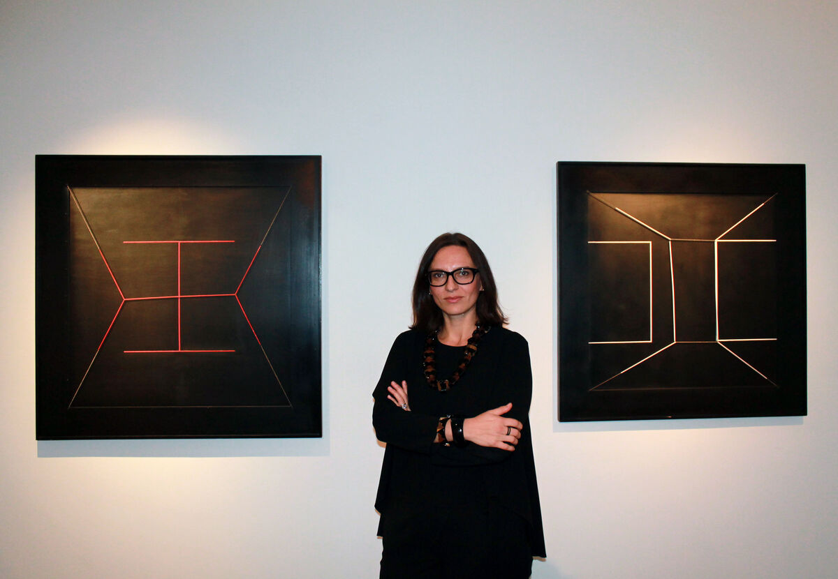 Mira Dimitrova, director of Robilant + Voena, with two works by Gianni Colombo. Photo courtesy of Robilant + Voena.