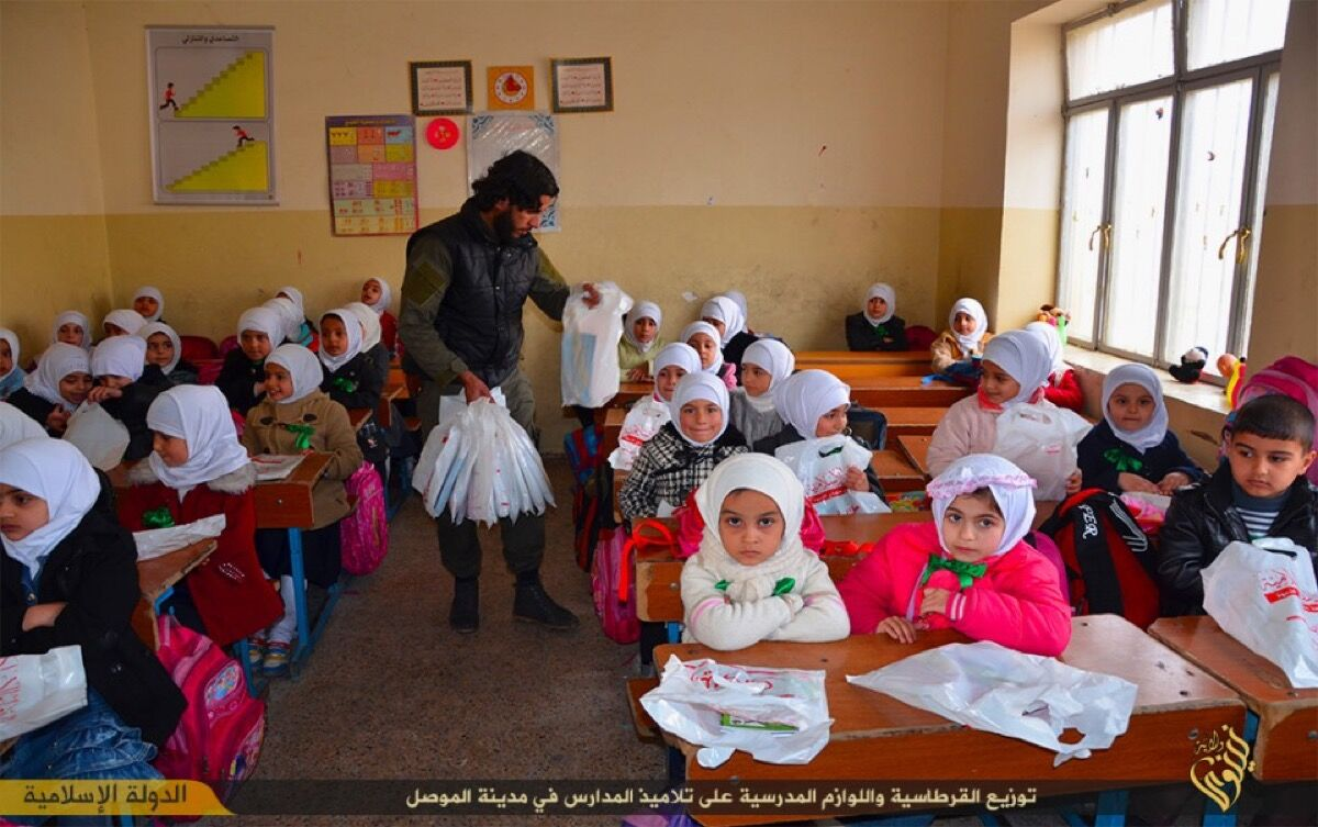 ISIS distributes school supplies to girls in Mosul, Iraq, 2015. Courtesy ofICP Museum.