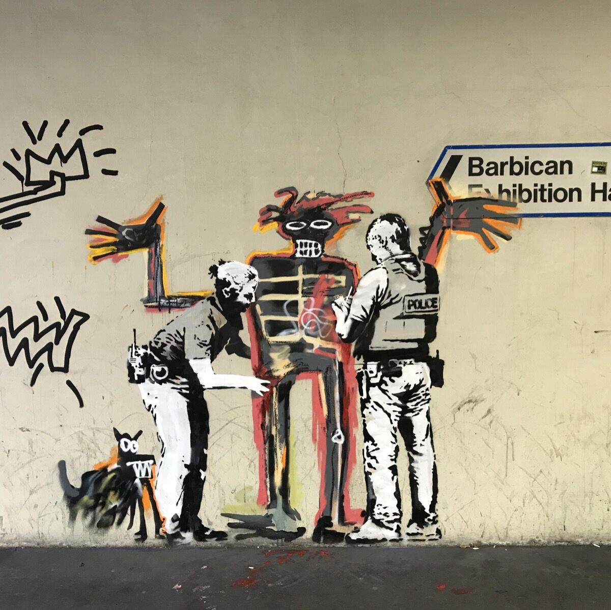 """Banksy, Basquiat being """"stopped-and-frisked"""" outside the Barbican Centre, 2017. Photo by Ungry Young Man, via Flickr."""