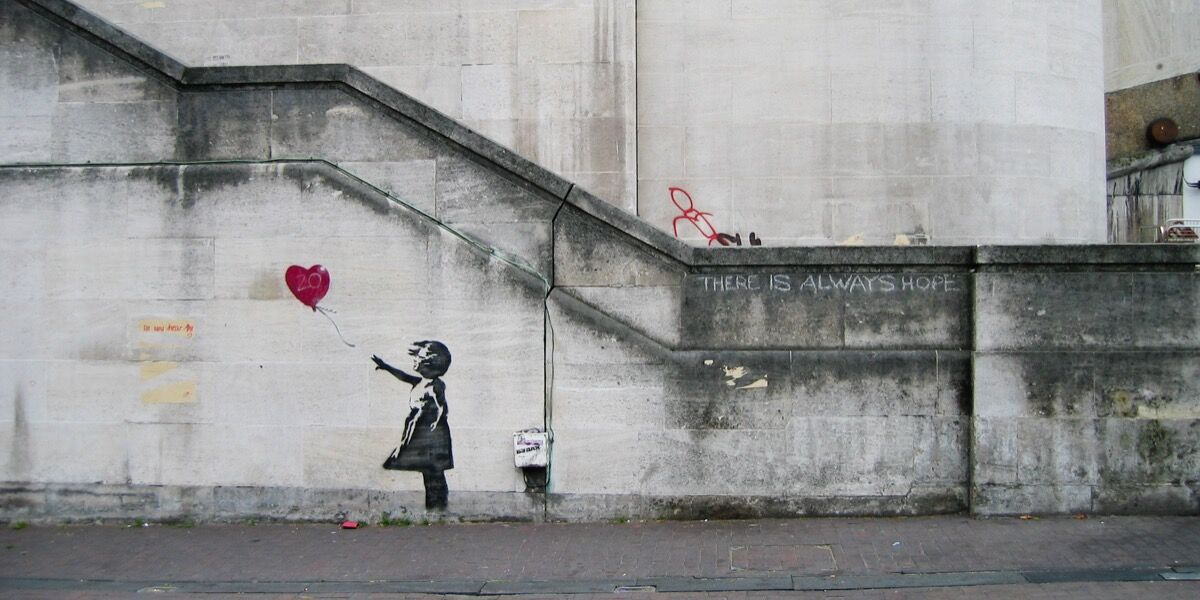 Banksy, Girl with Balloon. Photo by Dominic Robinson, via Flickr.
