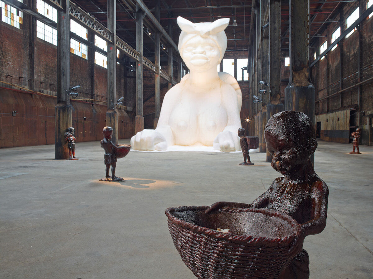 Kara Walker, At the behest of Creative Time Kara E. Walker has confected: A Subtlety, or the Marvelous Sugar Baby an Homage to the unpaid and overworked Artisans who have refined our Sweet tastes from the cane fields to the Kitchens of the New World on the Occasion of the demolition of the Domino Sugar Refining Plant, 2014, a project of Creative Time. Photo by Jason Wyche, © Kara Walker.