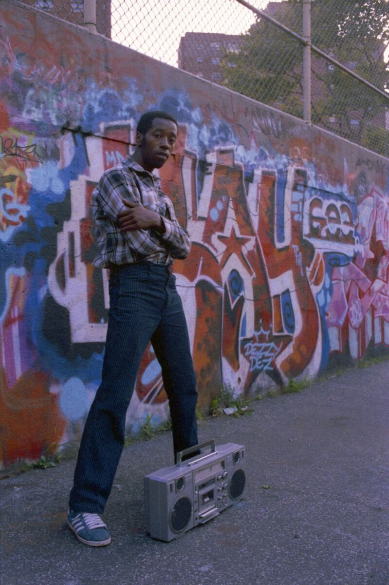 Henry Chalfant, DEZ TFA at his Kay Gee wall, Graffiti Hall of Fame, 106th St and Broadway, Manhattan, 1983. © 2018 Henry Chalfant / Artists Rights Society (ARS), New York. Courtesy Eric Firestone Gallery, New York.