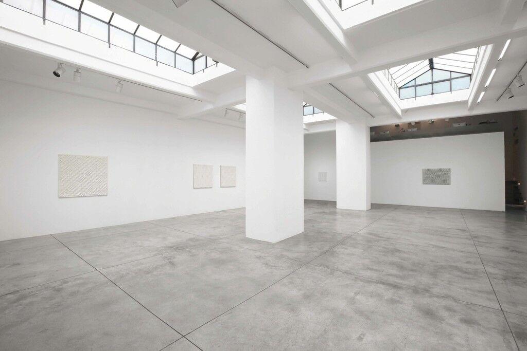 """Installation view of """"Enrico Castellani: Alla radice del non illusorio"""" at Cardi Gallery, 2015. Image courtesy Cardi Gallery."""