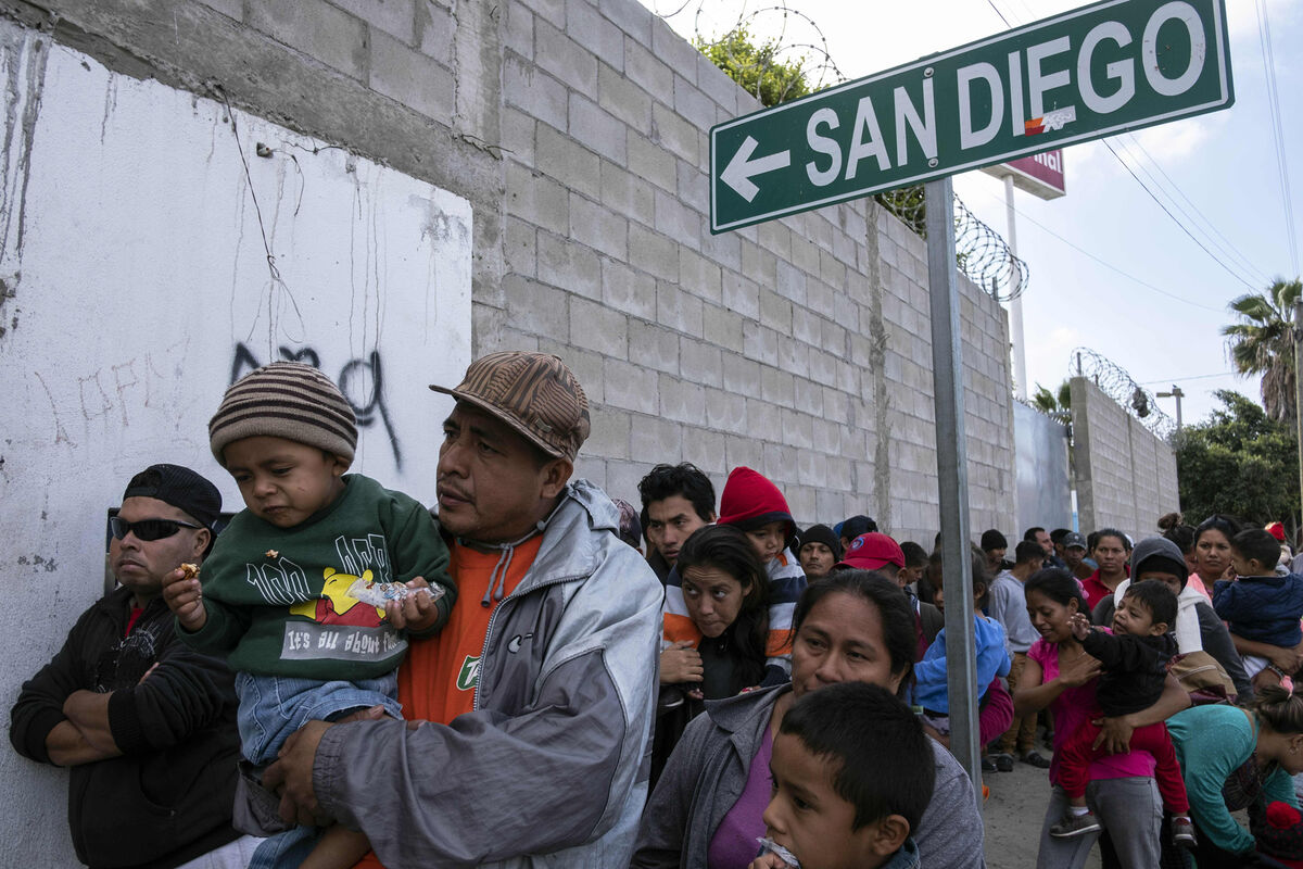 Central American migrants traveling in the 'Migrant Via Crucis' queue outside the Padre Chava's kitchen soup for breakfast and legal counseling, in Tijuana, Baja California State, Mexico, on April 27, 2018. Photo by Guillermo Arias/AFP/Getty Images.