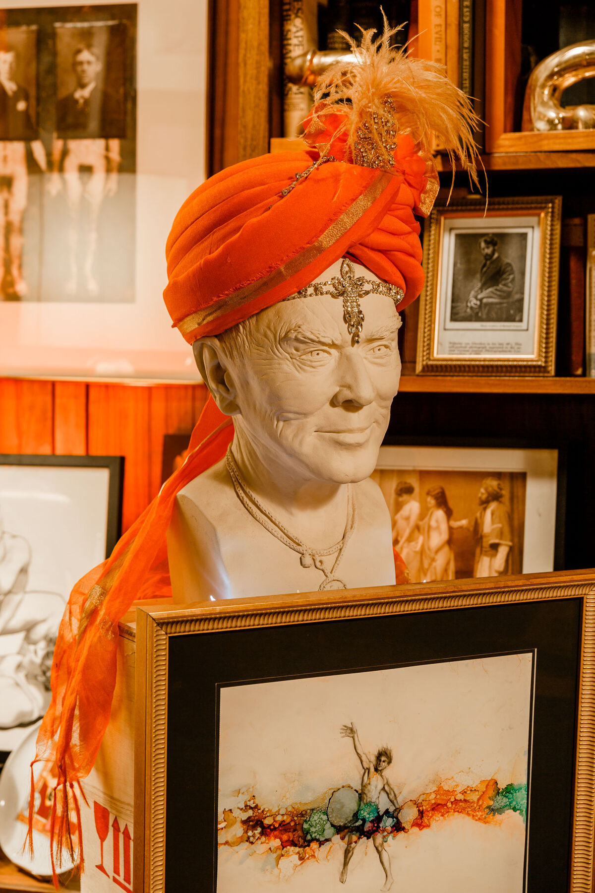 Kai Teichert's bust of Leslie, made in 2015, gives off a Carnac impression in the sitter's own addition, a feathered orange turban. Photo by Max Burkhalter for Artsy.