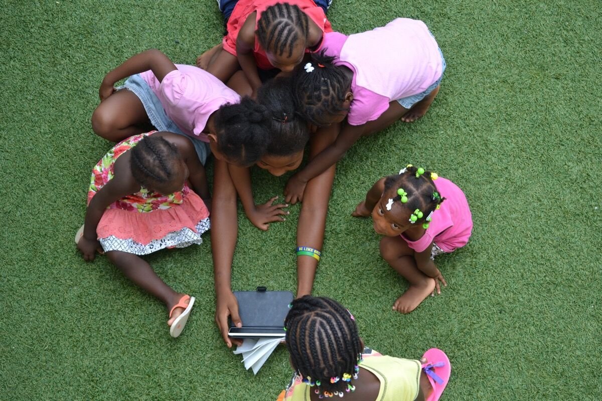 Students at the Be Like Brit Orphanage in Haiti using the NABU.ORG reading app. Photo by Bridgette Jean-Jacques. Courtesy of NABU.ORG.