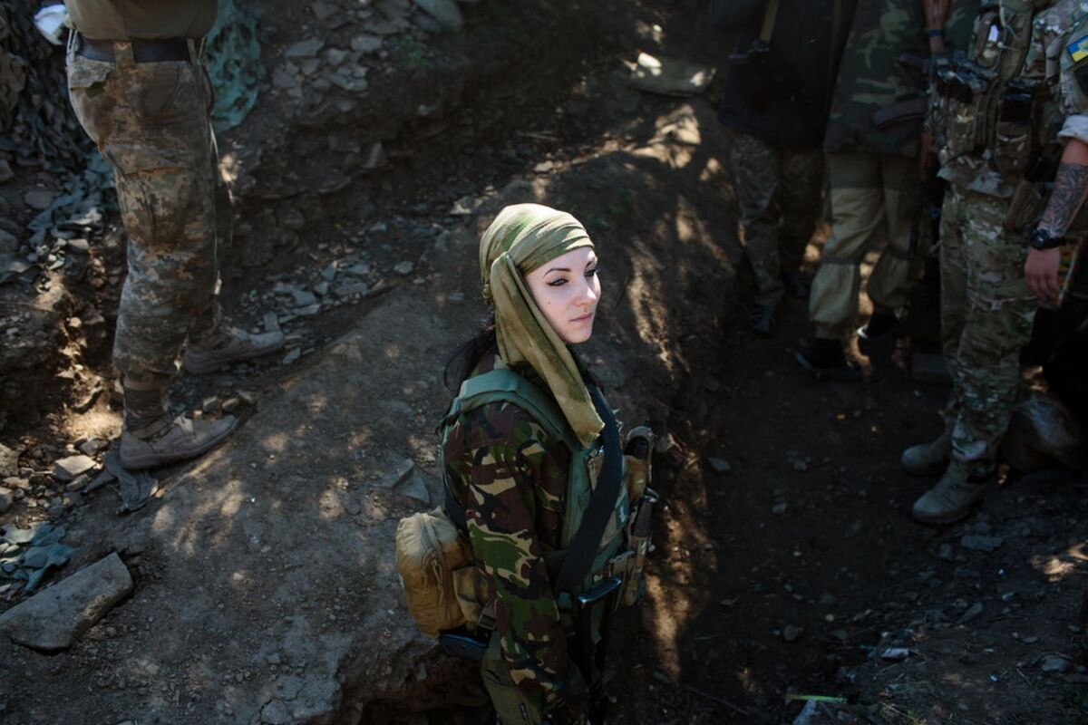 Nika, 24, a sniper for the Ukrainian army, on September 2, 2016, posted near the front line. Photo by Sarah Blesener. Courtesy of the artist.