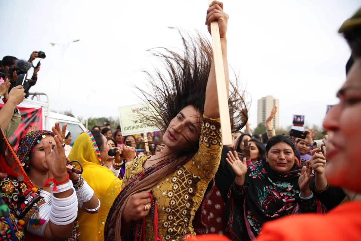 Julie Aman, who is transgender, dances to a folk band at the Aurat March event celebrating International Women's Day in Islamabad, Pakistan, on March 8, 2019.  Photo by Saiyna Bashir for Reuters. Courtesy of the artist.