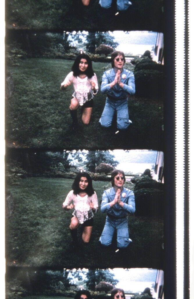 John & Yoko Posing for a Polaroid to be delivered to George Maciunas