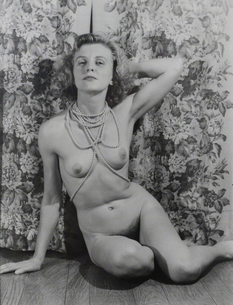 Untitled (Marie nude with pearls, arm behind head, looks to viewer)