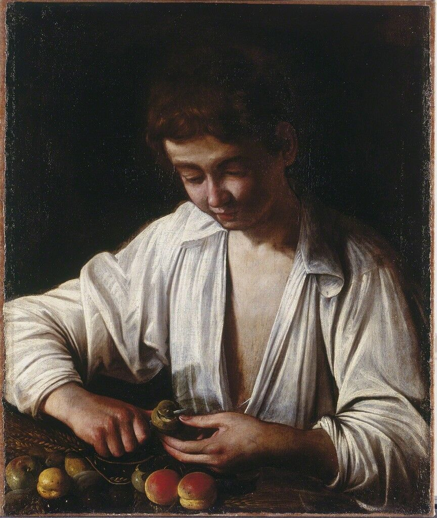 Boy peeling fruit