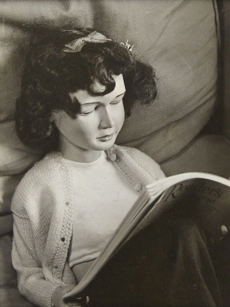 """[Doll Reading """"Readers Digest,"""" Portrait from """"Family Found""""]"""