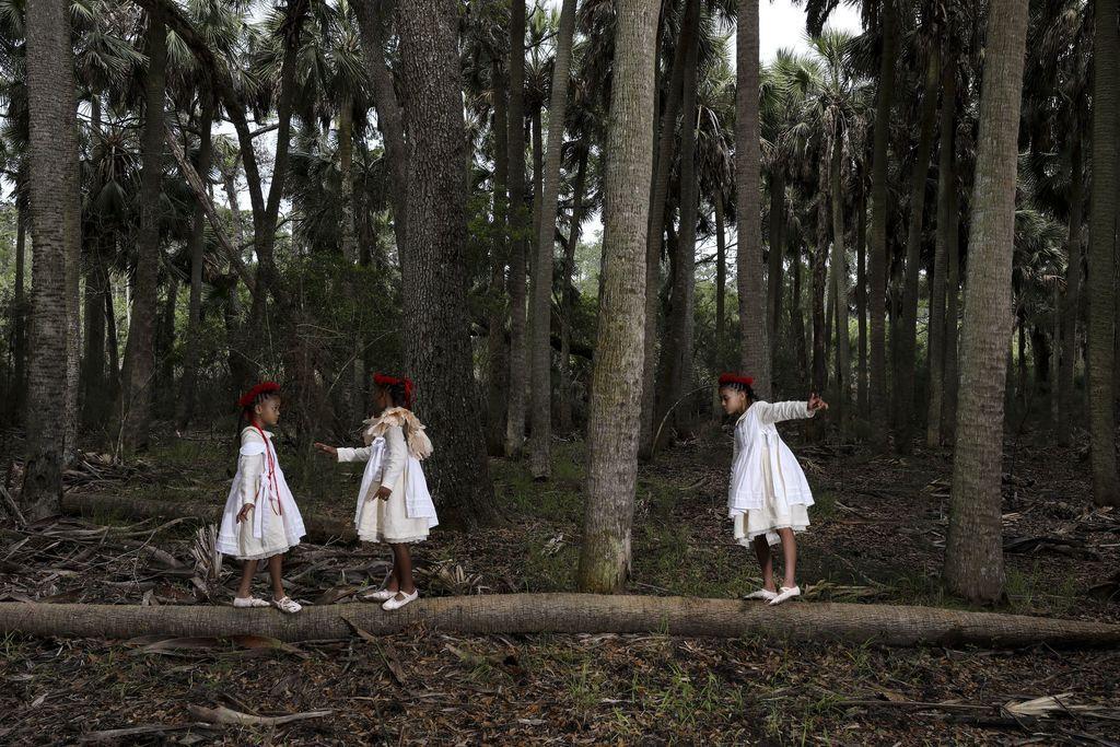Three girls in sabal palm forest III