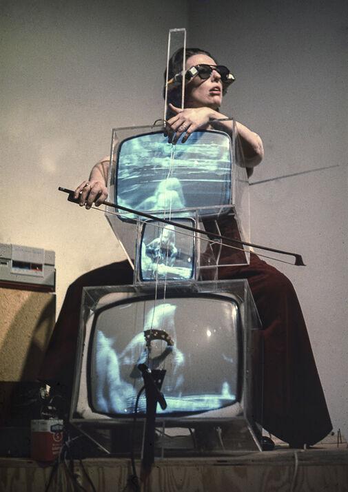 Charlotte Moorman performing on Nam June Paik's TV Cello wearing TV Glasses, Bonino Gallery, New York City