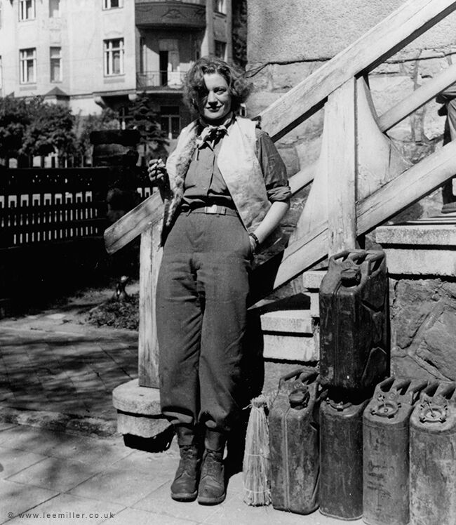Lee Miller with the essentials of Life, cigarette , wine and petrol , Weimar, by David Sherman