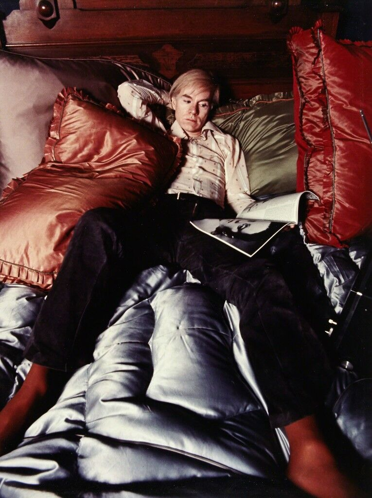 [Andy Warhol on his bed]