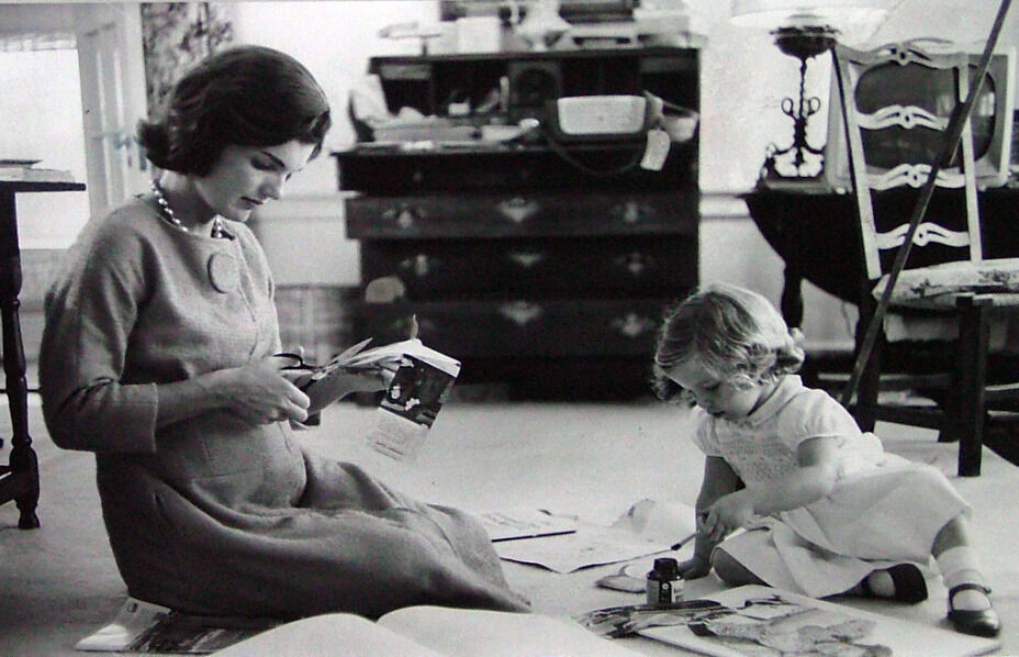 Jacqueline Kennedy, Wife of Senator with Scissors Cutting Out Newspaper Clippings Next to Open Scrapbook as Her Young Daughter Caroline Toys with the Applicator from a Glue Bottle, At Home, Hyannis Port, MA