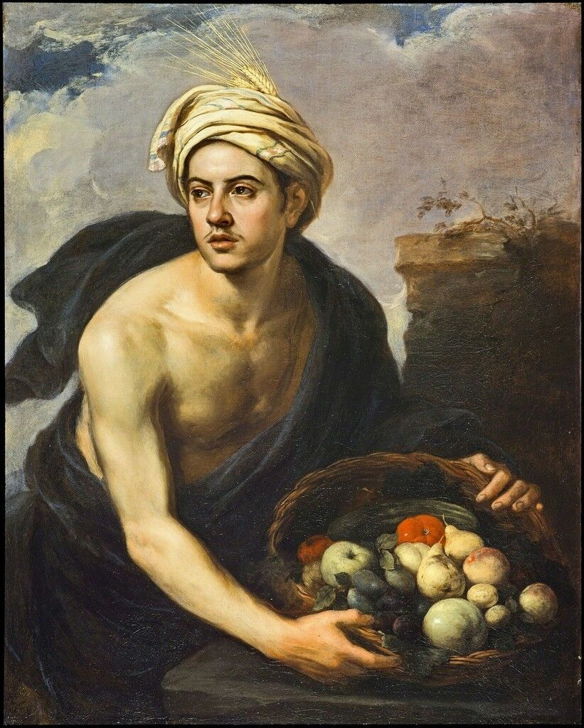 Junger Mann mit einem Fruchtkorb