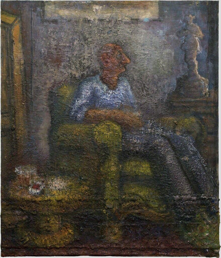 Man Sitting in an Armchair