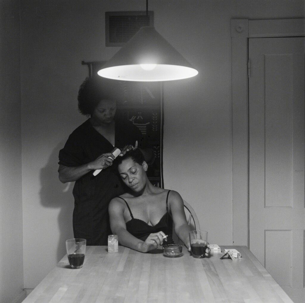 Untitled (Woman brushing hair)