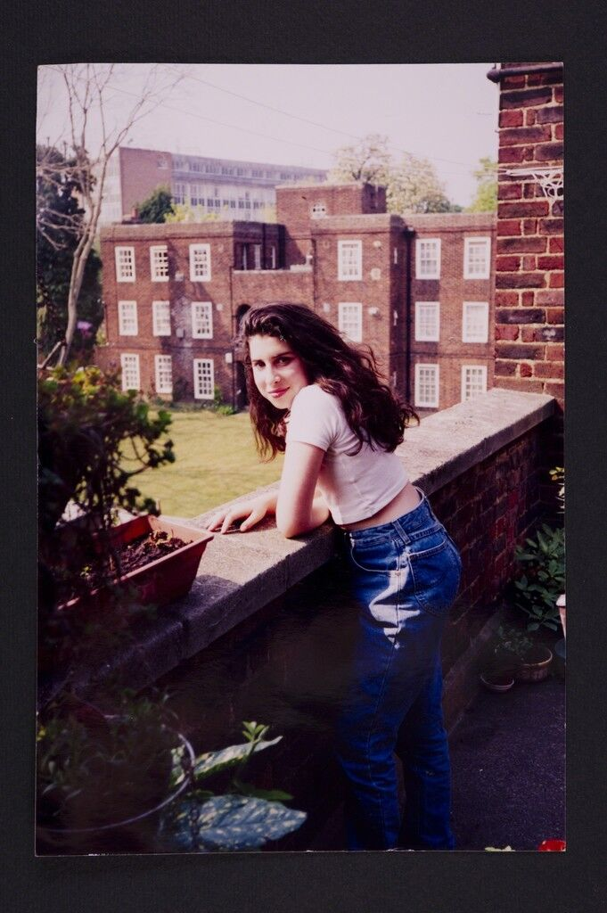 A young Amy outside her Grandma's flat in Southgate