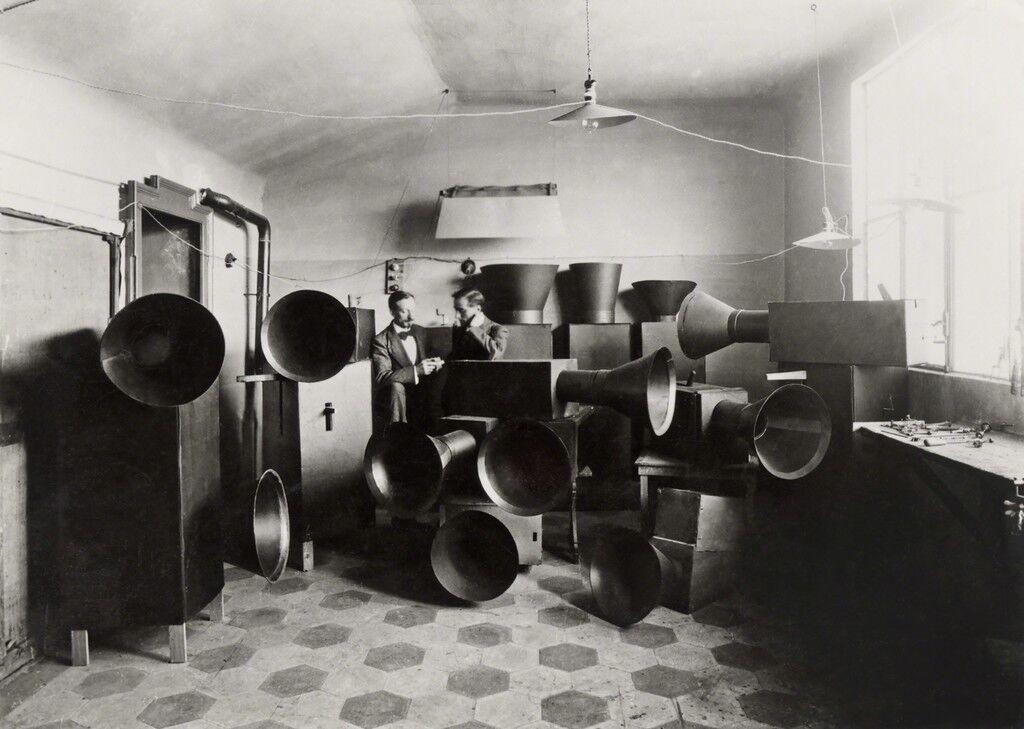 Luigi Russolo and his assistant Ugo Piatti in his studio with the intonarumori (noise machines), Milan