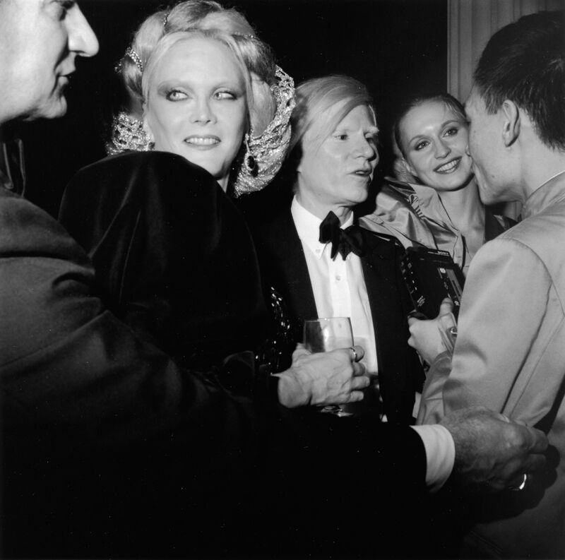 Monique van Vooren, Andy Warhol, his entourage, and Tseng Kwong Chi