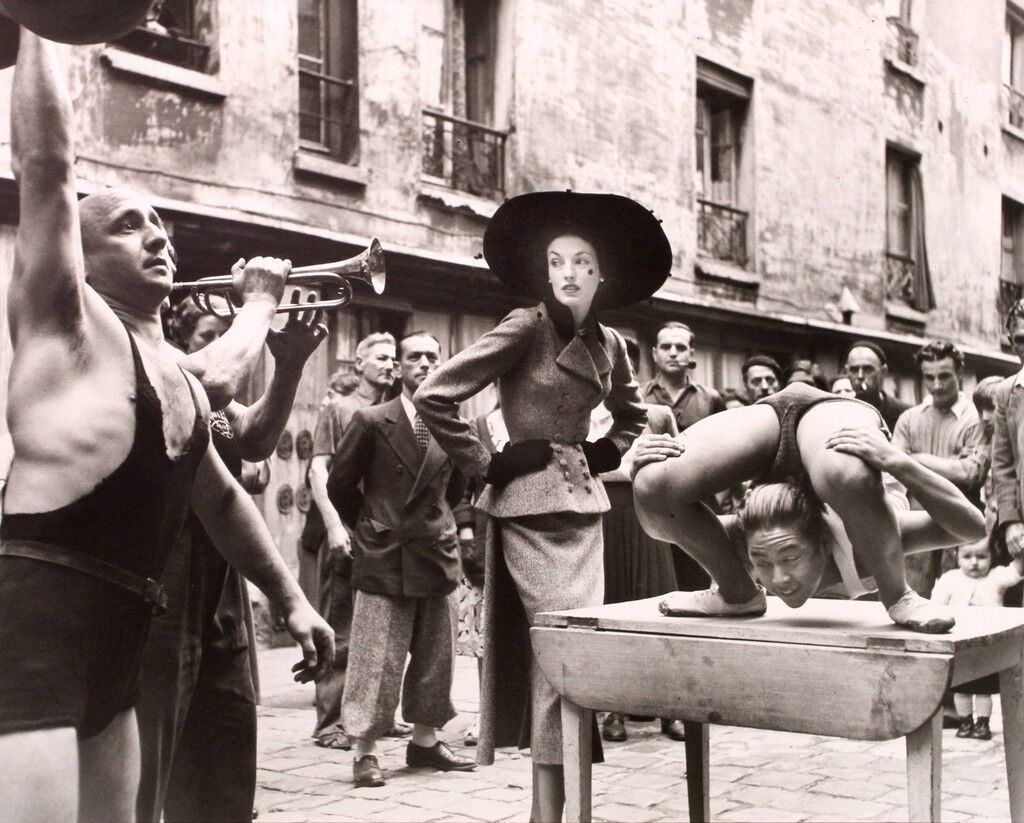 Elise Daniels with Street Performers, Suit by Balenciaga, Le Marais, Paris, August 1948