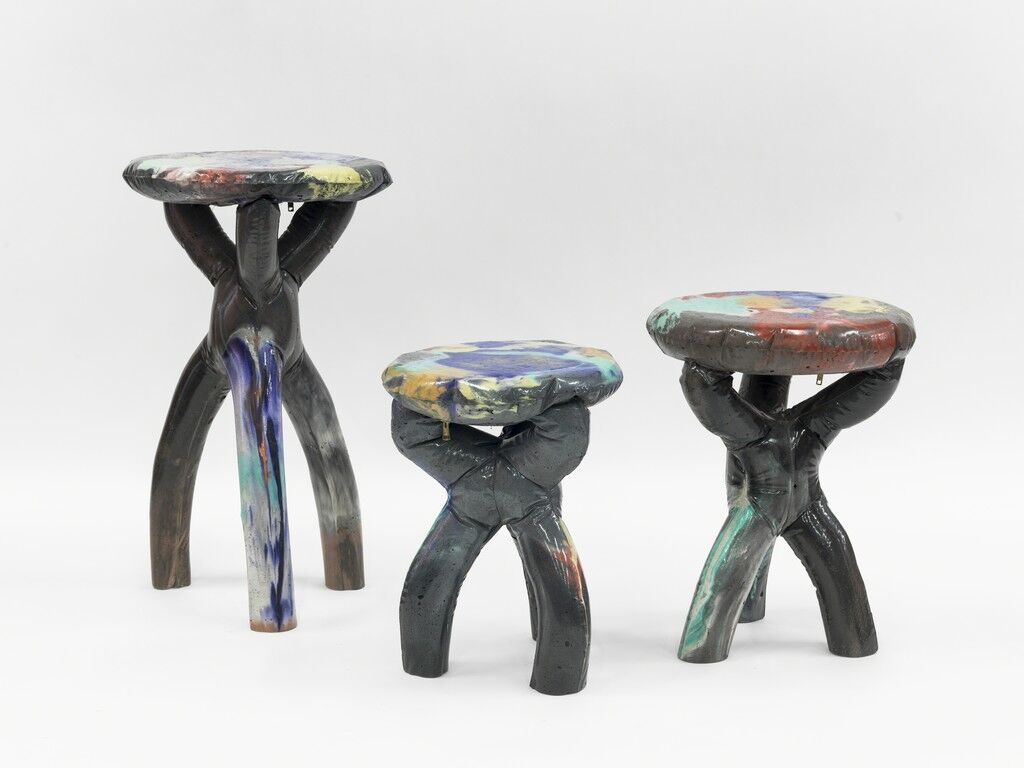 Group of black cement stools