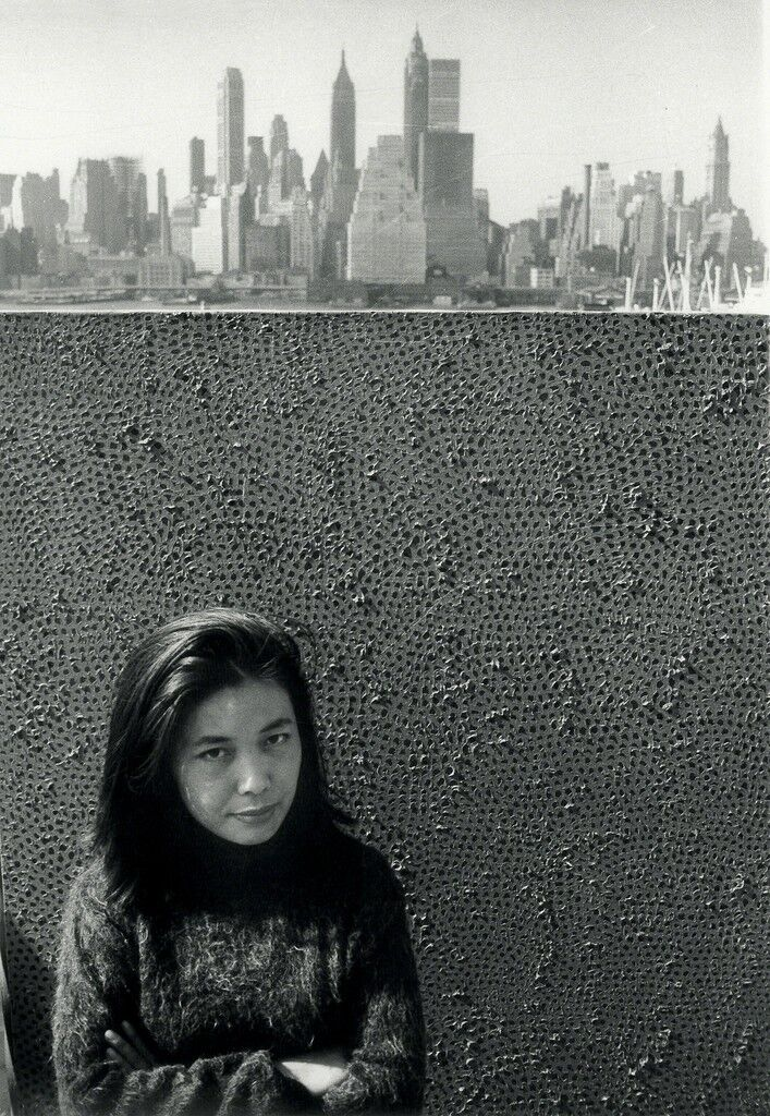Yayoi Kusama with one of her Infinity Net paintings in New York