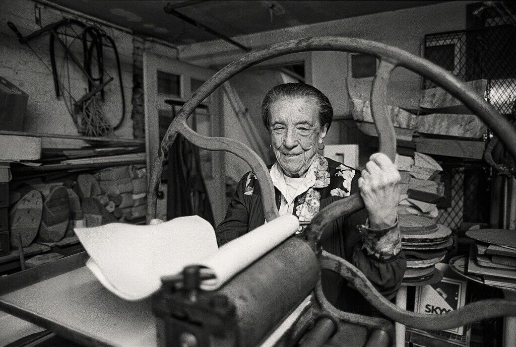 Louise Bourgeois at the printing press in the lower level of her home/studio on 20thStreet, New York