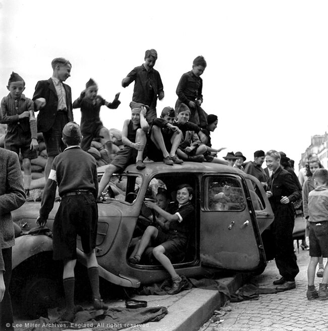 Children celebrating the liberation of Paris, France
