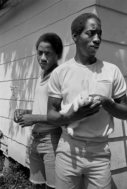 Young men with rabbit, Baton Rouge, Louisiana