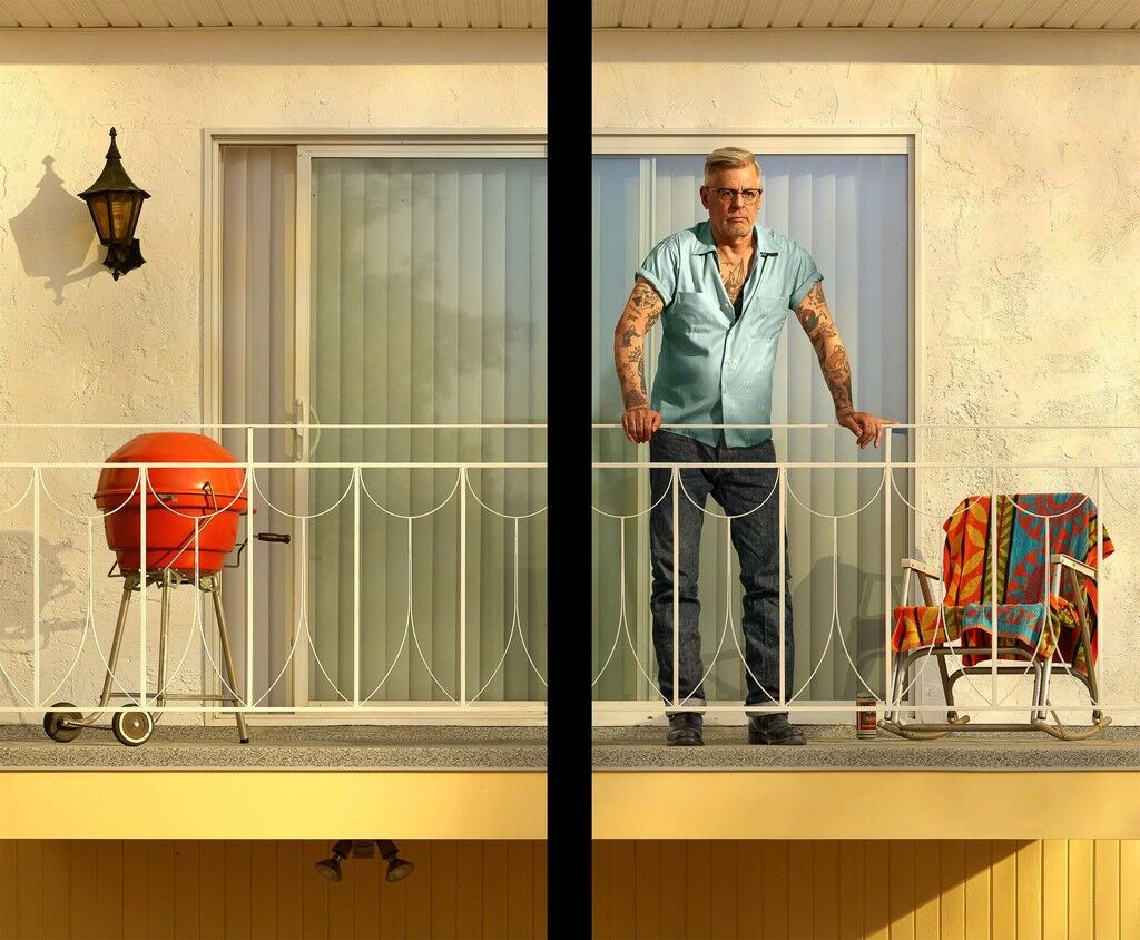 Tattooed Man on Balcony
