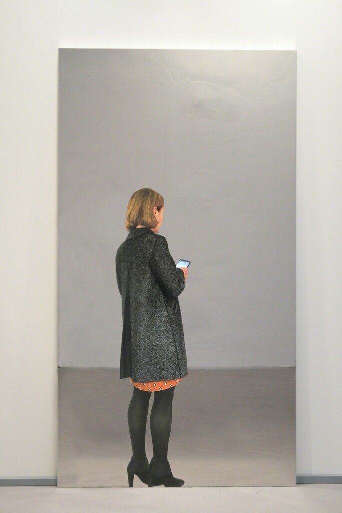Woman with coat and smartphone